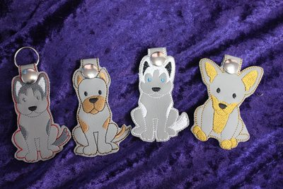 Cartoon Dog Keyrings Please state which design £  + P&P